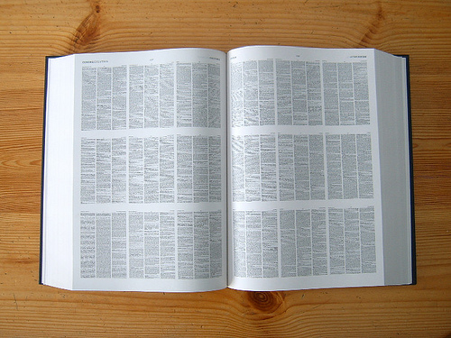 "2-page spread from the OED, containing 18 pages. The pages are about 10 x 14"" original size, then shrunk down for the Compact edition so that it can all fit in one 7-10 lb book instead of 20 big volumes. You have to read the thing with a magnifying glass. What fun!"