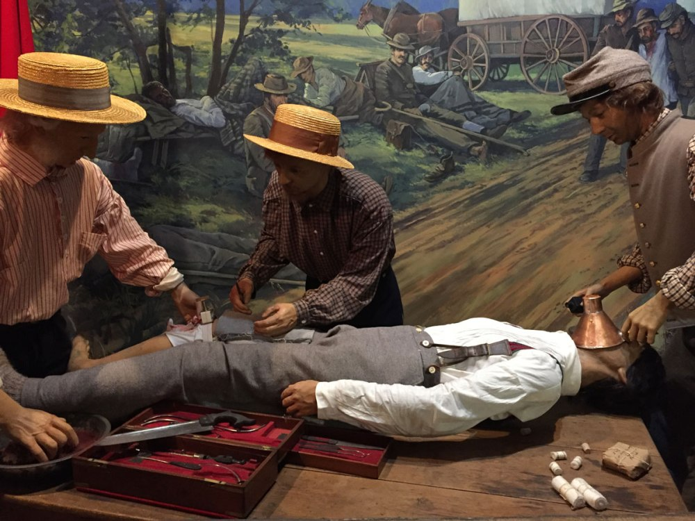 A diorama showing an amputation in progress. The table holding the figure is also from the war, and another prized possession in the museum's collection.
